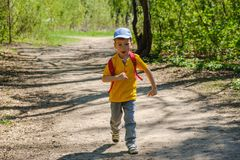 Happy boy on summer holidays. Outdoor activities, tourism. Happy boy on summer holidays. Outdoor activities, tourism and adventure stock image