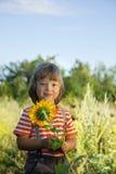 Happy boy with sunflower Stock Photo