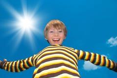 Happy boy on sunny day Stock Image