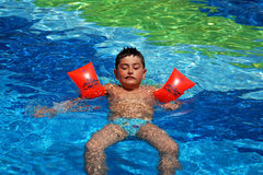 Happy boy swimming. Happy child have fun on water slike on outdoor swimming pool stock image
