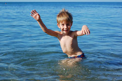 Happy boy swimming Royalty Free Stock Photos
