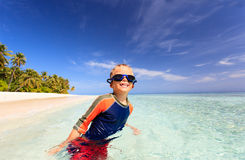 Happy boy in swimming goggles on beach Royalty Free Stock Photography