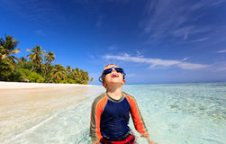 Happy boy in swimming goggles on beach Stock Photography