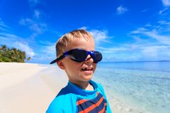 Happy boy in swimming goggles at the beach Royalty Free Stock Image
