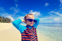 Happy boy in swimming goggles on beach Royalty Free Stock Image