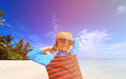 Happy boy in swimming goggles on beach Royalty Free Stock Photos
