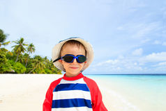 Happy boy in swimming goggles on beach Royalty Free Stock Images