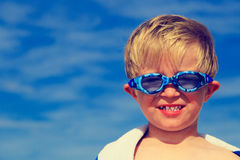 Happy boy in swimming goggles on sea vacation Royalty Free Stock Photography