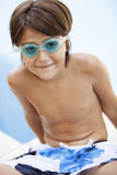 Happy boy with swimming goggles Royalty Free Stock Photos