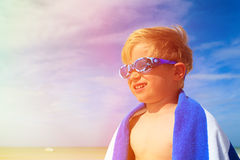 Happy boy in swimming goggles on summer beach Stock Photo