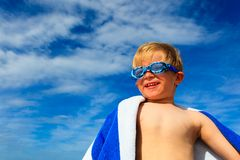 Happy boy in swimming goggles on summer beach Stock Photography