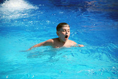 Happy boy swimming in the pool Royalty Free Stock Photography