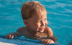 Happy boy in the swimming pool Royalty Free Stock Photography