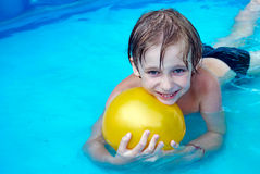 Happy boy swimming in a pool. Young boy swimming in a pool Stock Images