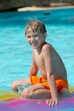 Happy boy in swimming pool Royalty Free Stock Images