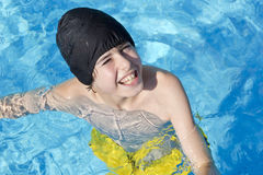 Happy Boy is  in the Swimming Pool Stock Photo