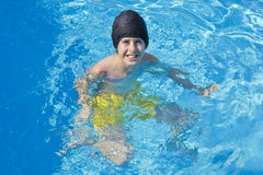 Happy Boy is  in the Swimming Pool Stock Images