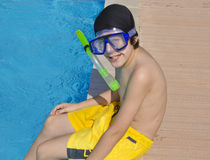 Happy Boy is  in the Swimming Pool Stock Image