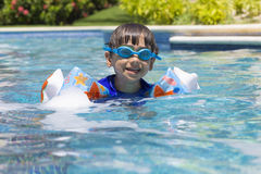 Happy Boy in the Swimming Pool Stock Photography