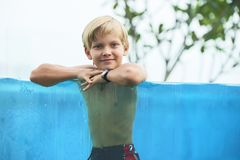 Happy boy in swimming pool stock photography