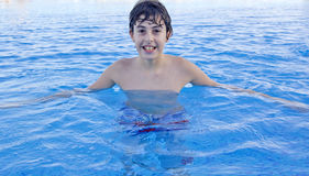Happy boy in the swimming pool. Happy teen  in the swimming pool Royalty Free Stock Images