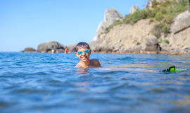 Happy boy swimming in the sea Stock Image