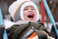 Happy boy on swing. Happy boy on a swing Royalty Free Stock Images