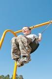 Happy boy on swing Stock Image