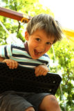 A happy boy on a swing 4 stock photos