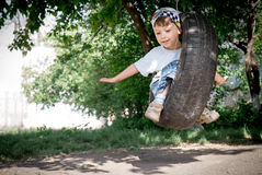 Happy boy on swing Royalty Free Stock Photography