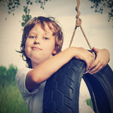 Happy boy on swing Royalty Free Stock Photo