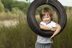 Happy boy on swing Stock Photography