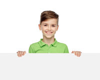 Happy boy in t-shirt holding white blank board Royalty Free Stock Photo
