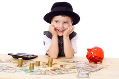 Happy boy at the table with money Royalty Free Stock Photos