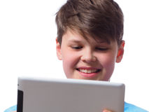 Happy boy with a tablet computer Royalty Free Stock Photography