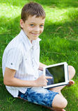 Happy boy with tablet Royalty Free Stock Photo