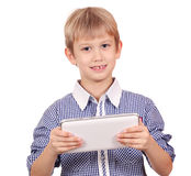 Happy boy with tablet pc Stock Photo