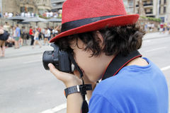 Happy boy taking photograph in  Barcelona Stock Photography