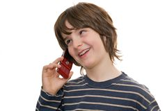 Happy boy talking on a mobile phone Stock Photos