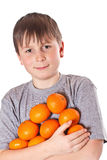 Happy boy with tangerines Royalty Free Stock Photos