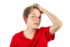 Happy boy tearing his hair Royalty Free Stock Images