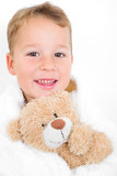Happy boy with teddy bear Royalty Free Stock Images
