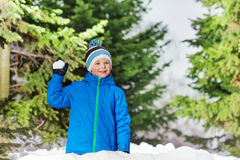 Happy boy throw snowball in the park Royalty Free Stock Photos