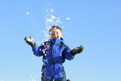 Happy boy throwing snow Stock Photo