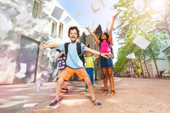 Happy boy throws papers in the air very excited royalty free stock images