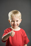 Happy boy with thumb up Stock Image