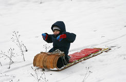 Happy Boy on Toboggan Royalty Free Stock Photo