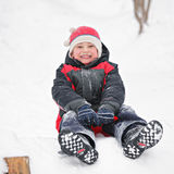 Happy boy on toboggan Stock Photography