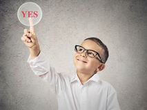 Happy boy touching yes button Royalty Free Stock Photos