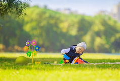 Happy  boy with toys at picnic Stock Images